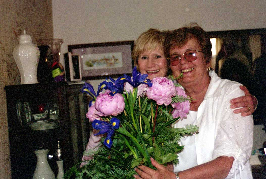 Pat Henderson with flowers